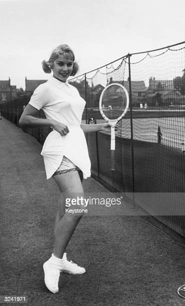 American tennis star Karol Fageros showing off her gold lame panties at the Northern Tennis Tournament at Manchester