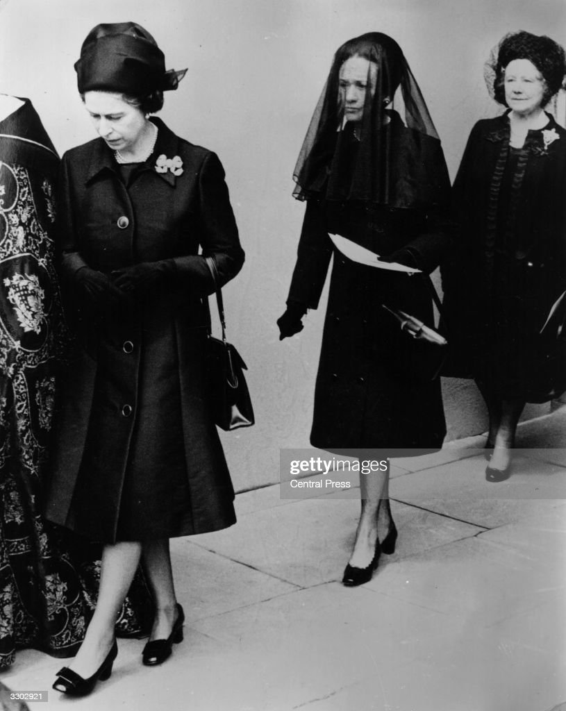 Queen Elizabeth II followed by the Duchess of Windsor (1896 - 1986) and Queen Elizabeth The Queen Mother (1900 - 2002) as they leave St Geoge's Chapel, Windsor after the funeral service for the Duke of Windsor, formerly King Edward VIII.