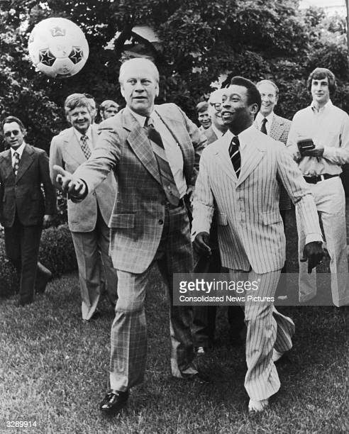 Brazilian footballer Pele jostling for the ball with Gerald Ford 38th President of the United States in the grounds of the White House Washington