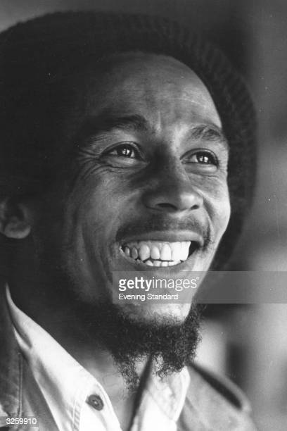 Singer, guitarist and composer of reggae music Bob Marley, , originally Robert Nesta Marley, in London.