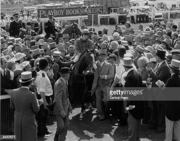 Karim Aga Khan IV the racehorse owner leading in the Derby winner 'Shergar' ridden by Walter Swinburn