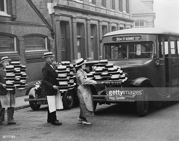 Completed straw hats being taken from the factory where they were made to packing rooms in St Albans