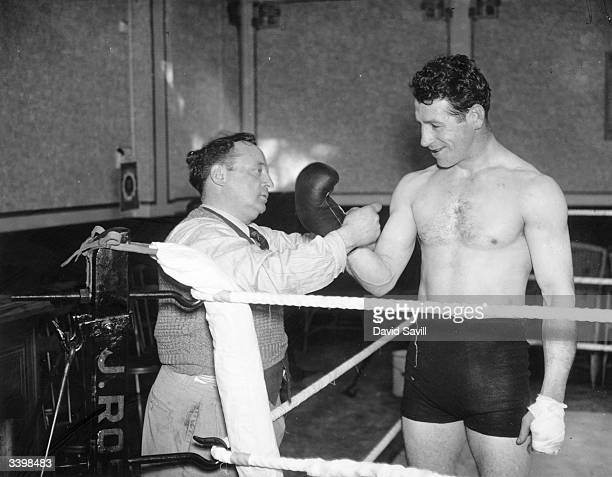 British boxer Len Harvey with his trainer Wally Mayes at Jack Straw's Castle Hampstead London where he is training for his forthcoming British...