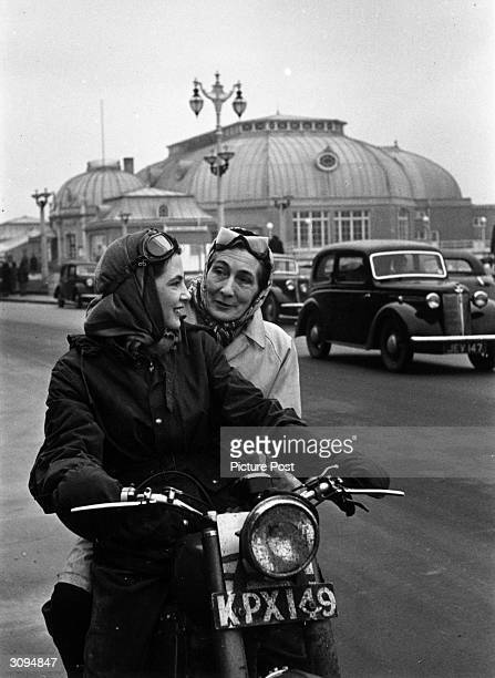 June Adams who competes in the 'male' world of motorcycle trials gives her mother a lift on the pillion of her motorbike Original Publication Picture...