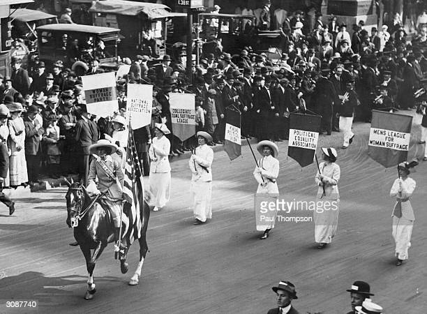 Grand Marshal Inez Milholland Boissevain leads a parade of 30000 representives of the various Women's Suffrage associations through New York City