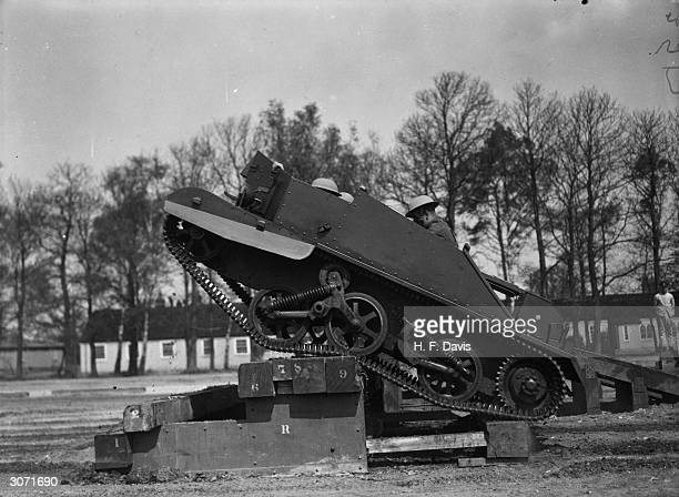 The 2nd Battalion Grenadier Guards negotiate obstacles in an armoured Bren Gun Carrier during a rehearsal of the Display of Modern Infantry Weapons...