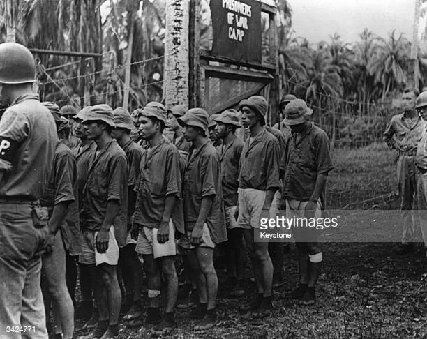 American marines taking Japanese prisoners of war away from the Solomon Islands as the army takes control