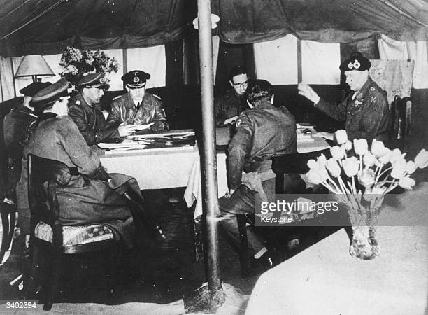Field Marshal Bernad L Montgomery gives his terms of surrender to the defeated German delegation headed by Admiral von Friedeburg General Kinzel and...