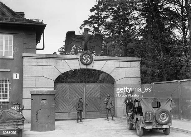 The main entrance to Dachau concentration camp The German eagle and a swastika stand guard over the gate
