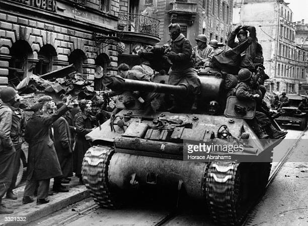 US tanks and troops advance along the Dachauerstrasse Munich to occupy the city