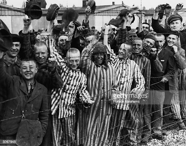 Young prisoners interned at Dachau concentration camp cheer the American troops who liberated the camp The boy third from left has been identified as...