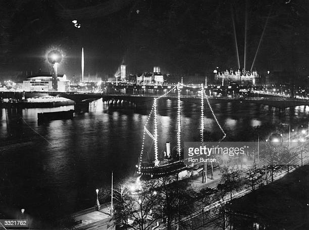 The River Thames is lit up as lights go on in full to mark the opening of the South Bank Festival of Britain Exhibition.