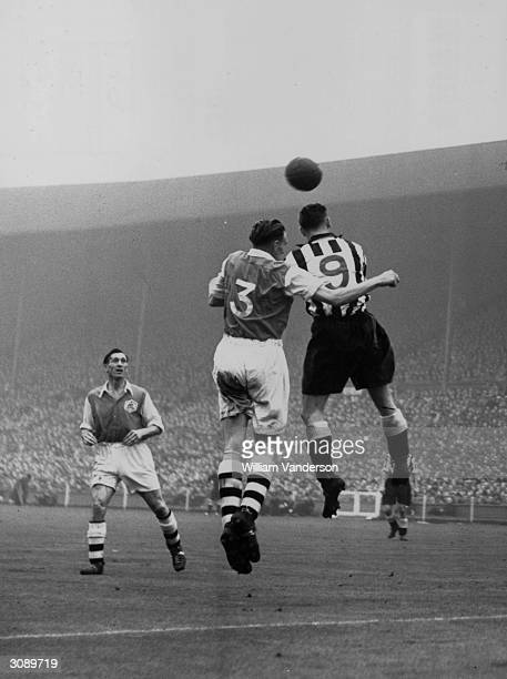 Newcastle United footballer Jackie MIlburn jumping for the ball against the Arsenal number three during the FA Cup Final at Wembley