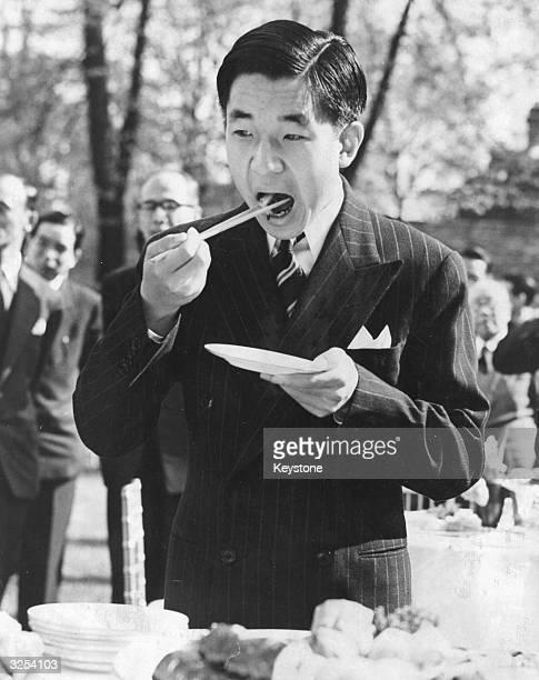 The Japanese Crown Prince Akihito enjoying a party at the Japanese Embassy Kensington London