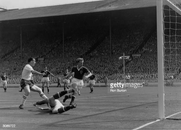 The Bolton Wanderers footballer Nat Lofthouse scoring against Manchester United in the FA Cup final