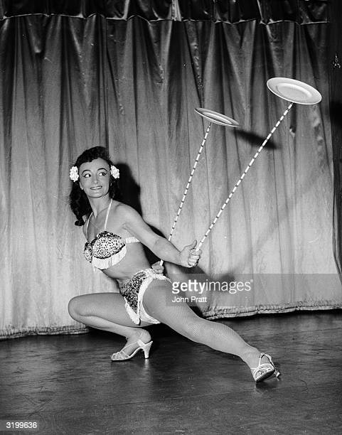 A plate balancing contortionist Eva May Wong shows off her wares as part of the variety act at the Arthur Fox Revue Bar in Manchester