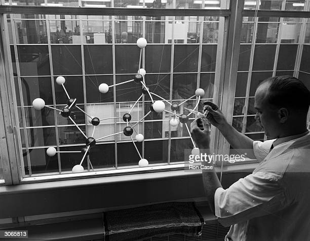 Scientist at work at the Radiochemical centre in Amersham, Buckinghamshire.