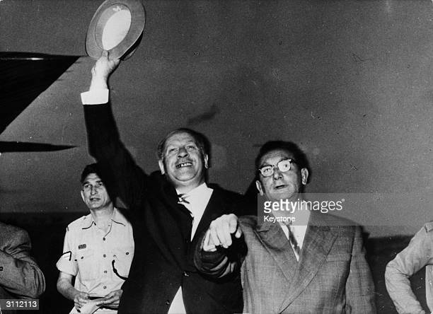German industrialist Oskar Schindler waving after his arrival at Jerusalem airport where he is to be honoured for saving the lives of over a thousand...