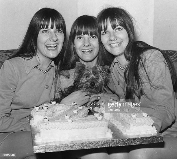 The Karlins singing triplets Linda Elaine and Evelyn Wilson celebrate their 21st birthday at Quaglino's in London with their dog Scouse