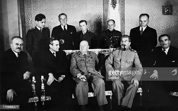 3rd moscow conference seated left to right vm molotov w harriman winston churchill jv stalin anthony eden standing vm berezhkov sir archibald kerr vn...