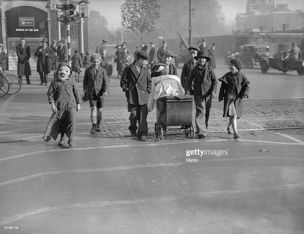 Children pushing a pram containing a guy to celebrate Guy Fawkes are using a 'pedestrian lane' in Kennington Road, south London, a new concept in road safety.