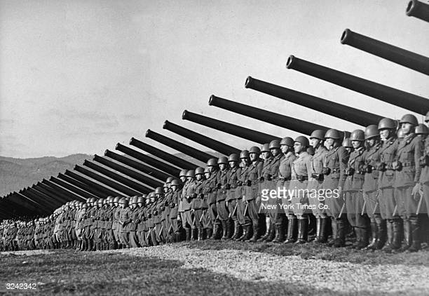 Italian troops line up with their guns along the Yugoslavian border for an inspection by Fascist dictator Benito Mussolini World War II Italy