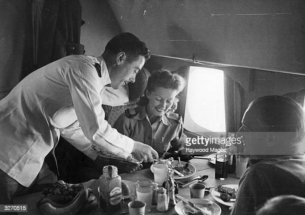 British film actress Winifred Shotter and Jack Lester have lunch at 6000 feet during their flight to India Original Publication Picture Post 3018 The...