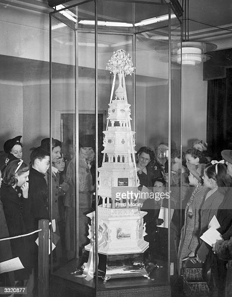 In the buildup to the marriage of Princess Elizabeth to the Duke of Edinburgh visitors to the Huntley and Palmer factory in Reading Berkshire view a...