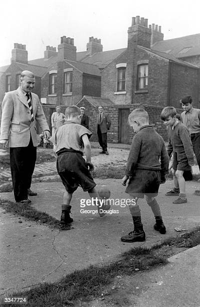 A group of young boys practise their football skills on the Middlesbrough streets with their team idol Wilf Mannion Original Publication Picture Post...