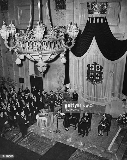 Prince Philip listens as Princess Elizabeth later Queen Elizabeth II of Great Britain makes a speech in the city hall of Montreal Canada
