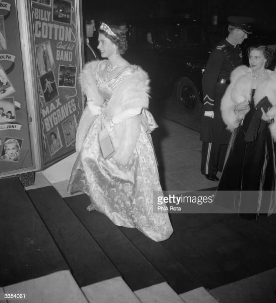 Queen Elizabeth II ascends the stairs at the London Palladium, to take her seat for the Royal Variety Command Performance.