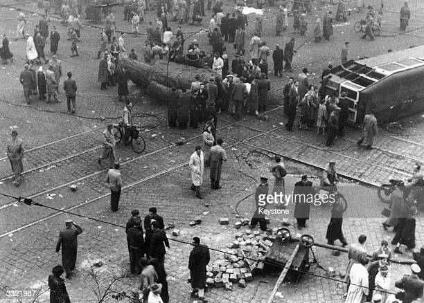 A huge statue of Stalin is dismantled near the National Theatre as Hungarians rebel against Soviet rule