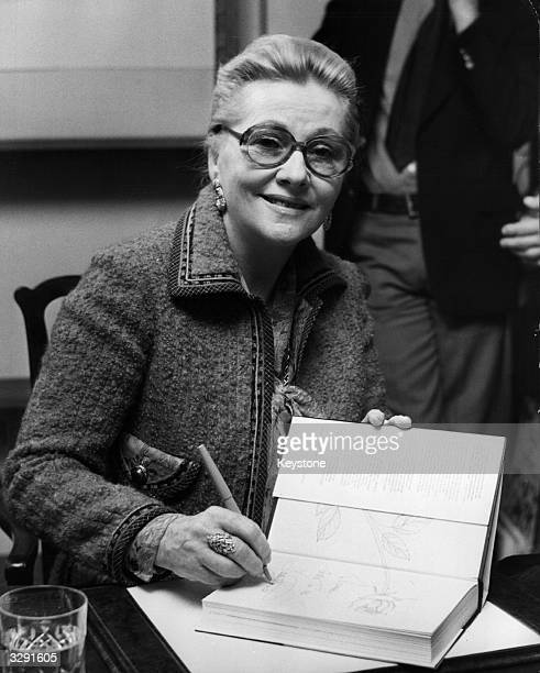 Britishborn actress Joan Fontaine signs copies of her autobiography 'No Bed Of Roses' at Liberty's book shop in Regent Street London