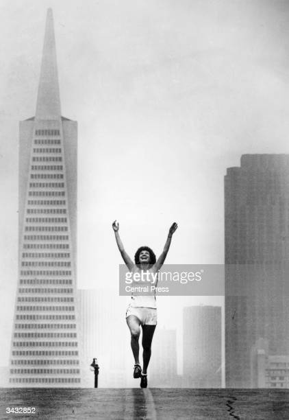 Early morning jogger Nancy Glasser has the streets to herself on Telegraph Hill San Francisco On the left is the Transamerica building and on the...