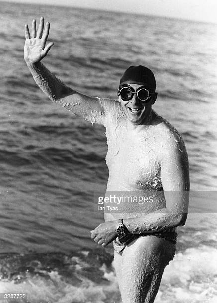 Mike Reid from Ipswich, about to enter the water at Dover in an effort to regain his title of 'King of the Channel'. He is covered in grease to help...