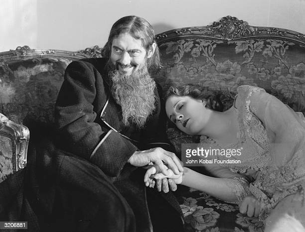 Lionel Barrymore holds the hand of a swooning Anne Shirley in 'Rasputin and the Empress' directed by Richard Boleslawski