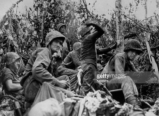 Using rifle grenades hand grenades and 'Molotov cocktails' members of the US Marine Corps attack a Japanese jungle position in Peleliu on the central...