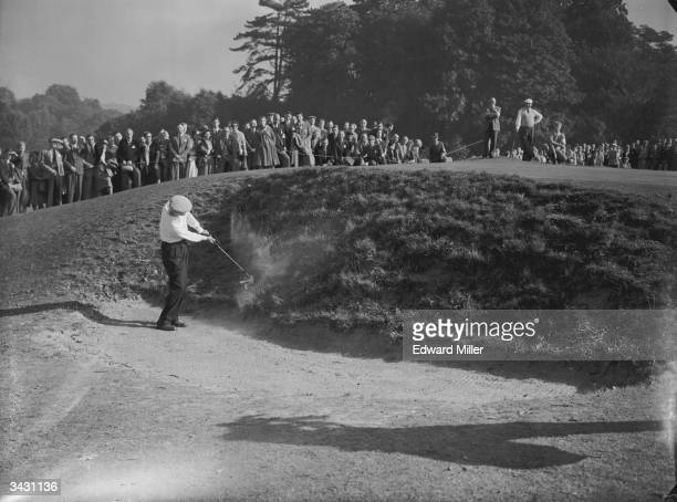 American golfer Fred Haas playing out of a bunker during the Ryder Cup at Wentworth Surrey
