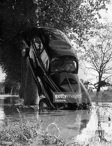 A car which was swept away by floods in the Anduzes region between Noziers and Ales in the Gard France has ended up slightly dented and tilted...