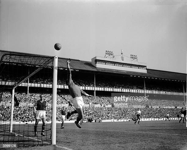 Burnley's goalkeeper Blacklaw tipes the ball over the crossbar from a shot by Tottenham Hotspur centre forward Bobby Smith during a match at White...