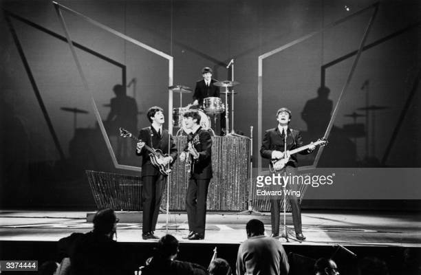 British pop group The Beatles on stage at the London Palladium