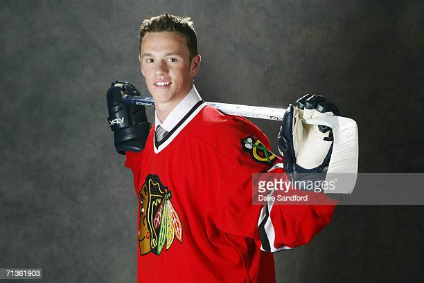3rd overall pick Jonathan Toews of the Chicago Blackhawks poses for a photo at the 2006 NHL Draft held at General Motors Place on June 24, 2006 in...