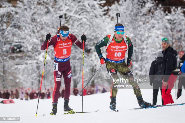 3rd place Erik Lesser of Germany and 4th place Anton Shipulin of Russia compete during the IBU Biathlon World Cup Men's Mass Start on December 17...