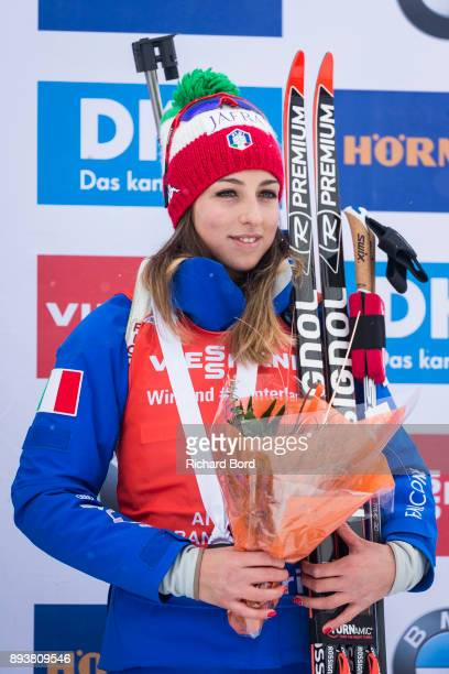 3rd place Lisa Vittozzi of Italy poses on the podium after the IBU Biathlon World Cup Women's Pursuit on December 16, 2017 in Le Grand Bornand,...