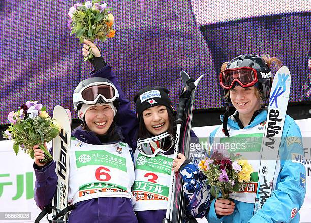 3rd Place Miki Ito winner Aiko Uemura of Japan and 3rd place Hannah Kearney of US pose on the podium in the Women's Dual Moguls during the FIS...
