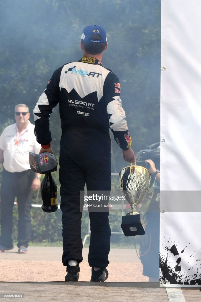 3rd place Sebastien Ogier of France leaves the stage after the flower ceremony after the WRC Germany on August 20, 2017 in Neunkirchen, western Germany. /