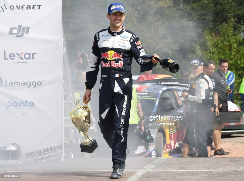 TOPSHOT - 3rd place Sebastien Ogier of France leaves the stage after the flower ceremony after the WRC Germany on August 20, 2017 in Neunkirchen, western Germany. /