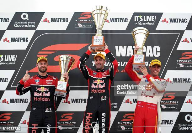 3rd place Shane Van Gisbergen driver of the Red Bull Holden Racing Team Holden Commodore VF 1st palce Jamie Whincup driver of the Red Bull Holden...