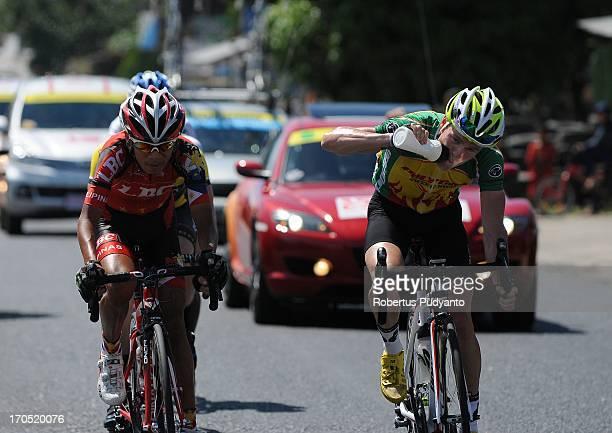 CONTENT] 3rd place winner Oscar Pujol Munoz of Polygon Sweet Nice Cycling Team drinking during stage 5 Tour de Singkarak 2013 start from Sawahlunto...