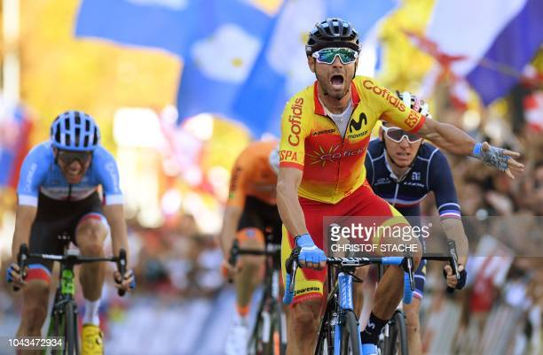 3rd placed Michael Woods of Canada winner Alejandro Valverde of Spain and 2nd placed Romain Bardet of France cross the finish line of the Men's Elite...